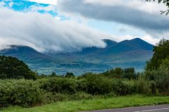 Mountains, Fields and Lake on Cloudy Day in Killarney Ireland. View of Mountains, Fields and Lake on Cloudy Day in Killarney Ireland Royalty Free Stock Photo