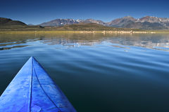 View of mountains form a kayak. Stock Image
