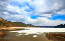 View of mountains and frozen lake with cloudscrape. Taken at Lianhuahu attractive sites , hailin city ,heilongjiang province , china Royalty Free Stock Photo