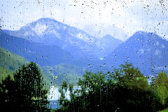 View of the mountains through the glass Stock Images
