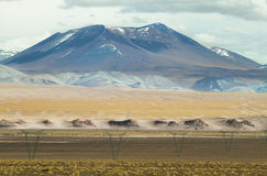 View of mountains and high voltage electric tower line. In Sico Pass, Argentina Royalty Free Stock Photography
