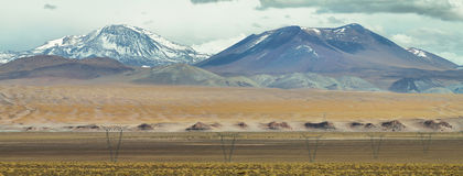 View of mountains and high voltage electric tower line. In Sico Pass, Argentina Royalty Free Stock Photo