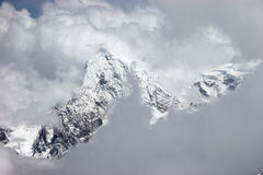 View of mountains through holes in clouds Stock Photo
