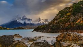 View of the mountains and the lake during the sunrise of Torres del Paine National Park. Autumn in Patagonia, the royalty free stock photo