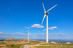 View of a mountains landscape with road and wind turbines on top. In Portugal, environment, electricity, mill, technology, environmental, nature, windmill stock photo