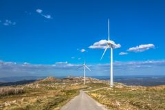 View of a mountains landscape with road and wind turbines on top. In Portugal, environment, electricity, mill, technology, environmental, nature, windmill royalty free stock photo