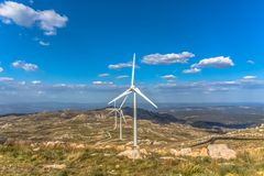 View of a mountains landscape with wind turbines on top. In Portugal, environment, electricity, mill, technology, environmental, nature, windmill, industry stock photography