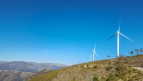 View of a mountains landscape with wind turbines on top. In Portugal, environment, electricity, mill, technology, environmental, nature, windmill, industry stock photo