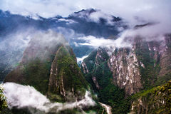 View of the mountains from Machu Picchu. Machu Picchu is a popular tourist attraction and one of the ancient wonders of the world royalty free stock image