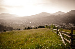 The view from the mountains meadow to the village Royalty Free Stock Photography