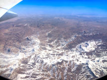 View of mountains from  plane Stock Photos