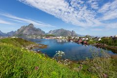 View of mountains and Reine in Lofoten islands, Norway. Beautiful summer day and blue sky. royalty free stock images