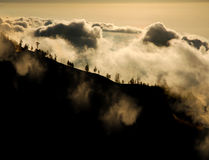 Mountain above clouds royalty free stock photography