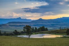 View of the mountains and a small lake, Drakensberg, South Afric. A Royalty Free Stock Photography