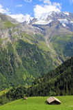 View at mountains with snow and waterfalls in Lauterbrunnen valley Switzerland. View at mountains with snow, glaciers, and waterfalls of the Lauterbrunnen valley royalty free stock photos
