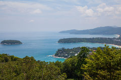 The view from the mountains to the sea. The view from the mountains to the blue sea and green island royalty free stock photography