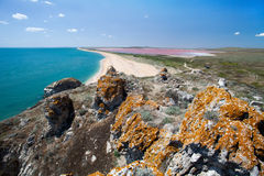 Sea coast and pink lake. View from the mountains to the sea coast and mud pink lake royalty free stock image