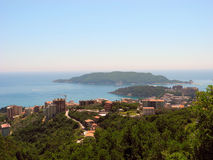 The view from the mountains to the town of Becici, and the island of St. Nikola in Montenegro. Royalty Free Stock Images