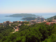The view from the mountains to the town of Becici, and the island of St. Nikola in Montenegro. Royalty Free Stock Photos