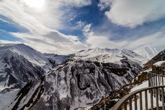View of the mountains under the snow from the observation deck, Georgian military road. Georgia. Gudauri stock image