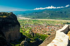 View of mountains and valley, town of Kalabaka from the top of rock Holy Trinity Monastery of Meteora Monasteries, Greece stock photo