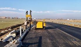 Mounting the roadside guardrail. View of Mounting the roadside guardrail Royalty Free Stock Images