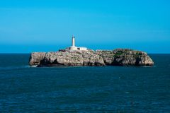 View of the Mouro Island and Lighthouse Isla y Faro de Mouro. Santander, Spain royalty free stock image