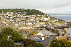 View of Mousehole Cornwall England on an overcast cloudy winter day. View of Mousehole harbour and fishing village Cornwall England UK on an overcast cloudy Royalty Free Stock Images