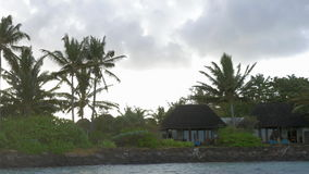 View of moving along coast with luxury bungalow hotel against cloudy sky, Mauritius Island stock video footage