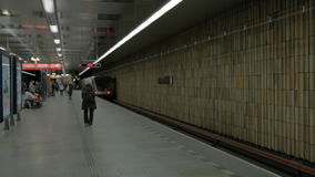 View of moving away subway train on the station. Prague, Czech Republic. View of moving away subway train on the station. Lighting electronic screen and subway stock video footage