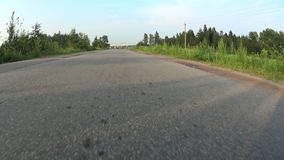 View from a moving car on a paved road.  stock footage