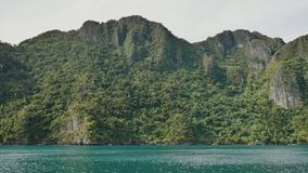 View from a moving ferry. The Busanga Mountains. Tropical landscape of the Palawan Islands. The city of Coron. Philippines stock footage