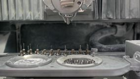 View at moving hi-speed spindle of dental milling machine. Moving high-speed spindle of a dental milling machine in a laboratory for prosthesis and crowns stock video footage