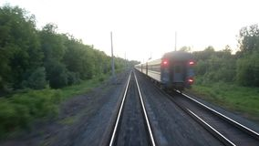 View from the moving train on railway tracks to the summer forest. Close up stock video footage