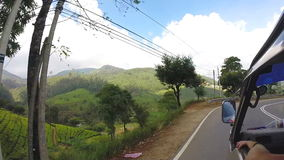 View from moving vehicle of tea plantations in the foothills on the roads of Sri Lanka. stock video