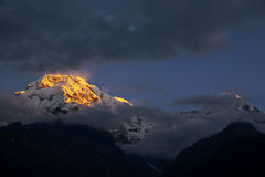 View of Mt. Annapurna III at Sunrise from Chomrong, Nepal. Royalty Free Stock Images