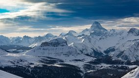 View of Mt Assiniboine from Sunshine Village. Peaks after peaks after peaks in the Canadian Rockies, as seen from Sunshine Ski Resort, in Banff National Park Royalty Free Stock Image