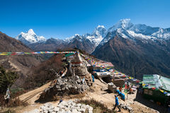 View of Mt. Thamserku, Kangteka and Ama Dablam from Mongla, Nepal. Mt. Ama Dablam, Kangteka and Thamserku as seen from Mongla village, Everest region trekking Royalty Free Stock Photography