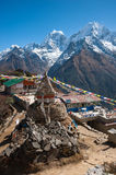 View of Mt. Thamserku and Mt. Kangteka from Mongla, Nepal. Buddhist stupa, with Mt. Kangteka and Thamserku as seen from Mongla village, Everest region trekking Royalty Free Stock Image