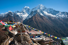 View of Mt. Thamserku and Mt. Kangteka from Mongla, Nepal. Buddhist stupa, with Mt. Kangteka and Thamserku as seen from Mongla village, Everest region trekking Royalty Free Stock Photography