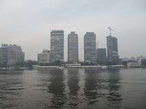 View of multi-storey houses in the center of Cairo from the Nile stock photography