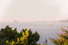 View of multiple Islets that stand out in the Pacific Ocean amid the haze in Southern Oregon, USA royalty free stock images