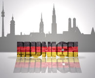 View of Munich. Word Munich with national flag of germany near skyline silhouette Royalty Free Stock Image