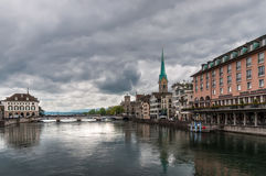 View of the Munster bridge over Limmat river in Zurich in cloudy Stock Images