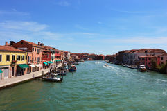 View on Murano Canal, Venice typical venetian construction houses with boats, sunny day, Venice Stock Photography