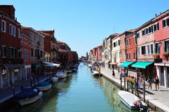 View on Murano Canal, Venice typical venetian construction houses with boats, sunny day, Venice Royalty Free Stock Image