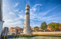 View of Murano lighhouse Faro in Murano island, a small island inside Venice Venezia area, famous for its glass production, It stock photography