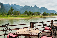 View of Nam Song River with Dining Table. At Vang Vieng, Laos Royalty Free Stock Photos