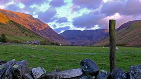 View of Nant Ffrancon Pass at Snowdonia National Park,with mount Tryfan in background Gwynedd, Wales, United Kingdom. View of Nant Ffrancon Pass at Snowdonia stock footage