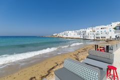 Naoussa village and beach - Aegean Sea - Paros Cyclades island - Greece. View of Naoussa village and beach - Aegean Sea - Paros Cyclades island - Greece royalty free stock image